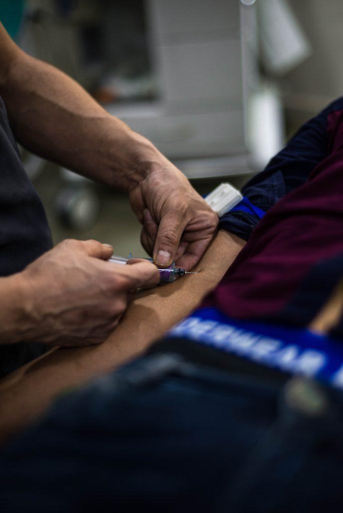 Dr. holding needle