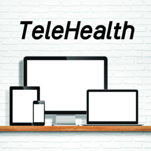Graphic of computers and mobile devices with word TeleHealth over